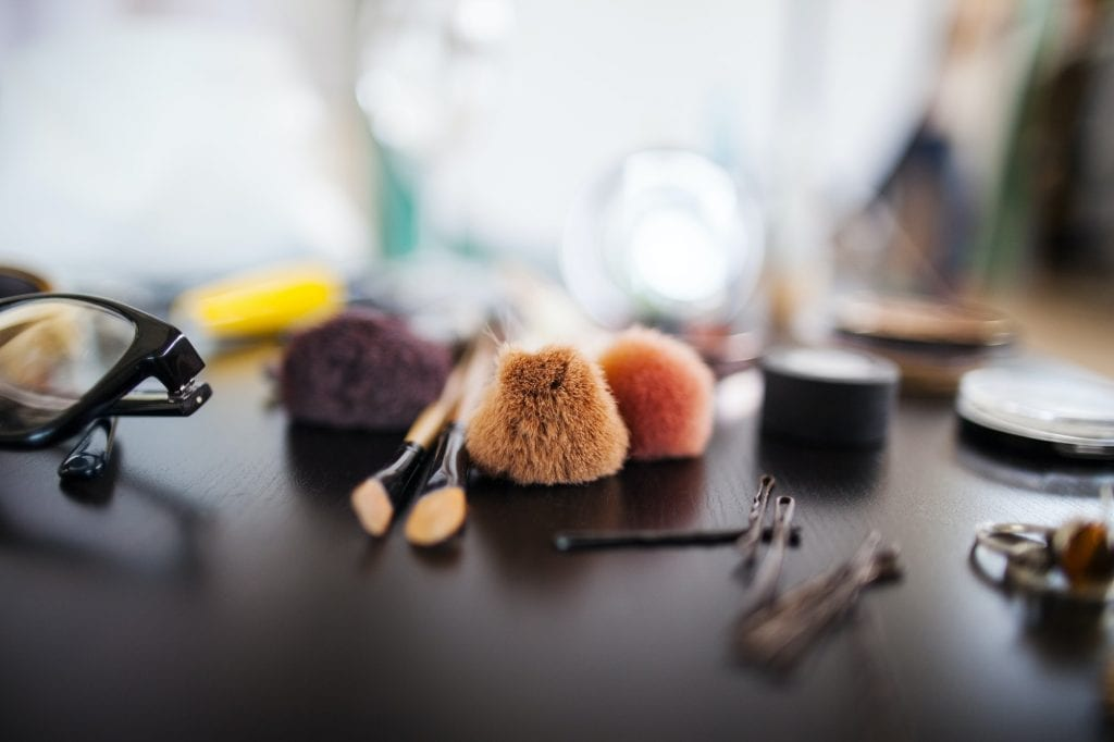 Various beauty products on table in studio